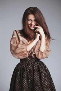 Beautiful girl in fashionable clothes. Studio portrait. romantic
