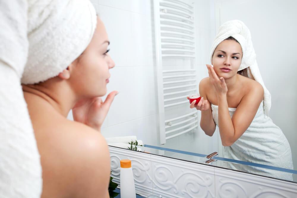 Vine-Vera-Skin-Care-Tips-woman-in-bathroom-mirror
